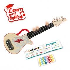 ukulele rosso a ritmo di luci
